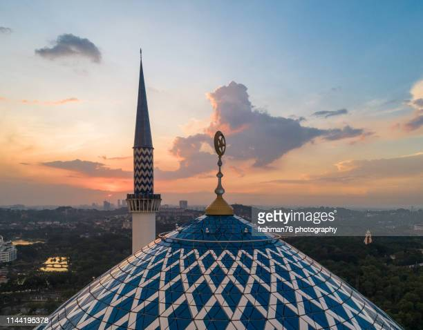 an aerial view of sultan salahuddin abdul aziz shah mosque during sunset - shah alam stock photos and pictures