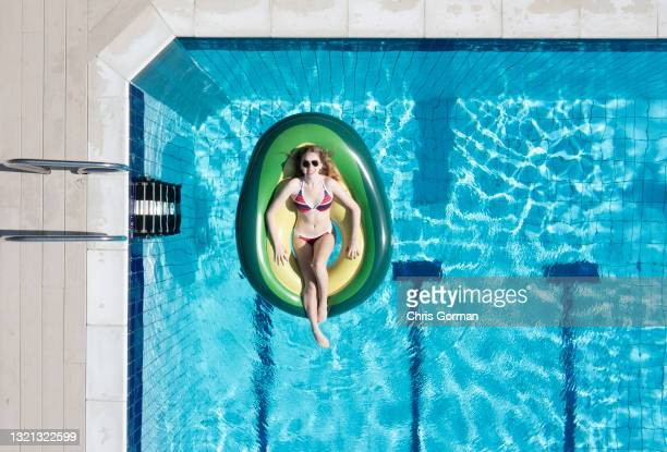 An aerial view of sunbather Eleanor Jacob posing for a portrait at Petersfield Open Air Pool on May 31,2021 in Petersfield, United Kingdom.