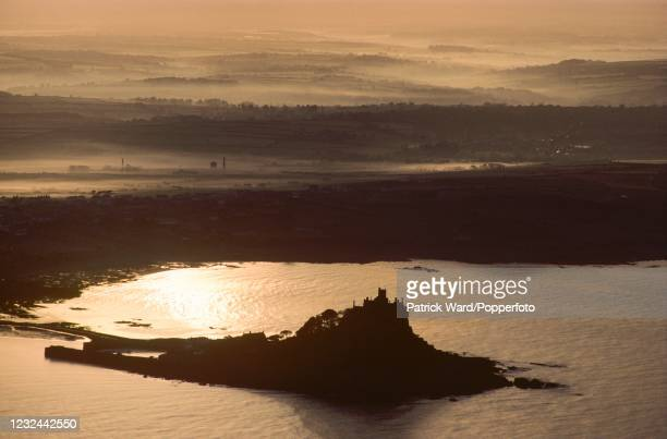 An aerial view of sunrise over the castle on Saint Michael's Mount in Cornwall, circa June 1985.