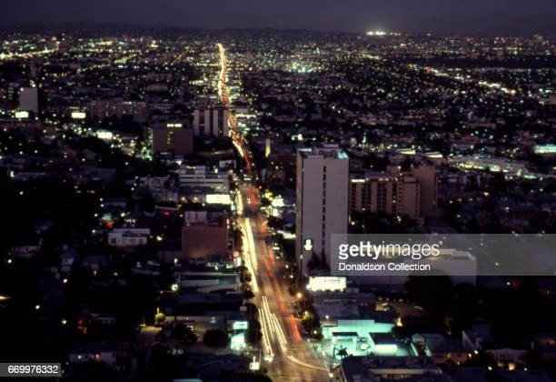An aerial view of Sunset Blvd looking East from Doheny Blvd with Santa Monica and West Hollywood at night in August 1992 in Los Angeles, California.