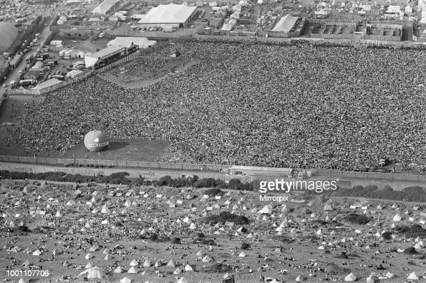 An aerial view of the 120,000 pop fans massed together at Freshwater on the Isle of Wight for the weekend pop festival. Pictures show the performance...