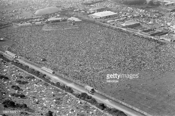 An aerial view of the 120000 pop fans massed together at Freshwater on the Isle of Wight for the weekend pop festival Pictures show the performance...