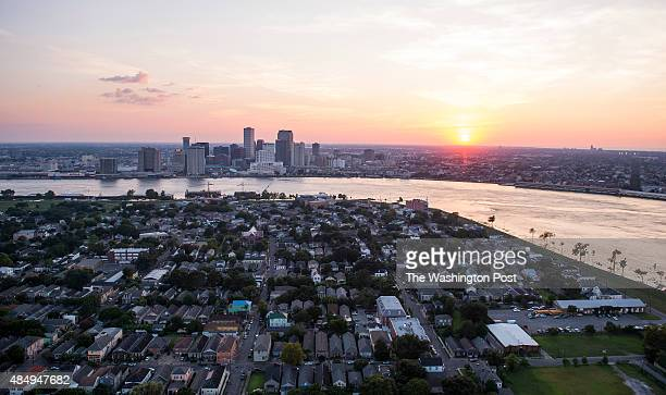 An aerial view of the Algiers neighborhood in the foreground with the downtown skyline on August 1 2015 in New Orleans La