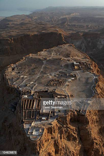 An aerial view of the ancient mountaintop fortress of Masada shortly before sunset on September 30 2010 on the shores of the Dead Sea in southern...