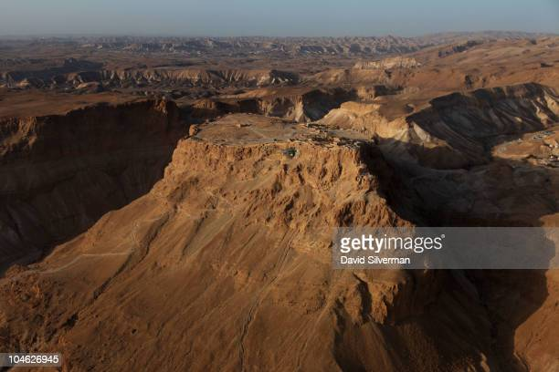 An aerial view of the ancient mountaintop fortress of Masada shortly after sunrise on October 1 2010 on the shores of the Dead Sea in southern Israel...
