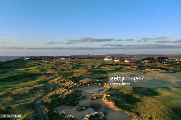 An aerial view of the approach to the green on the par 4, 17th hole with the par 4, 18th and clubhouse behind at The Royal Cinque Ports Golf Club on...