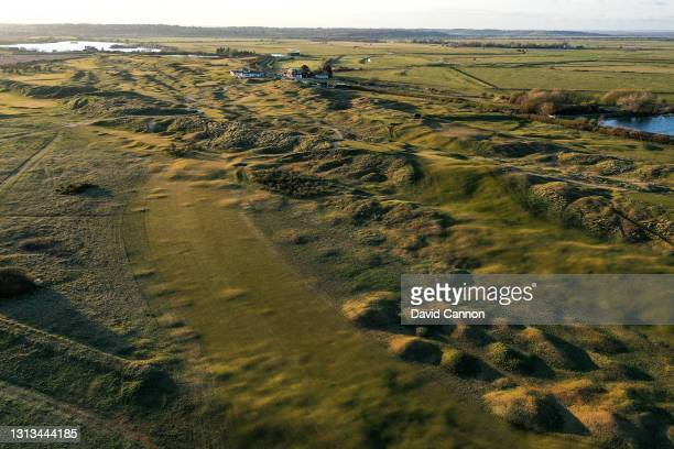 An aerial view of the approach to the green on the par 4, eighth hole looking towards the clubhouse at Rye Golf Club on April 15, 2021 in Camber,...