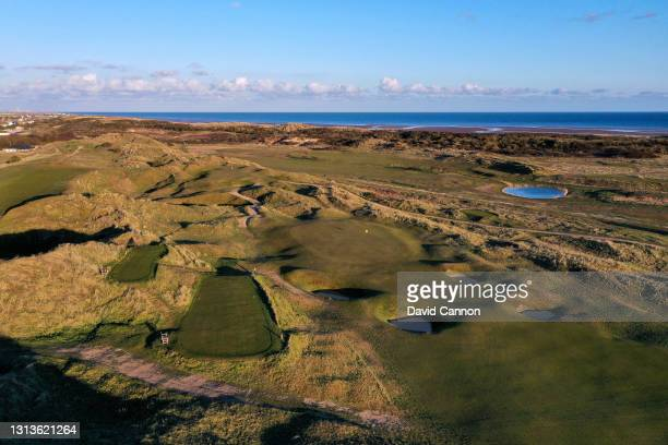 An aerial view of the approach to the green on the par 4, sixth hole with the par 3, seventh hole at Rye Golf Club on April 15, 2021 in Camber, East...