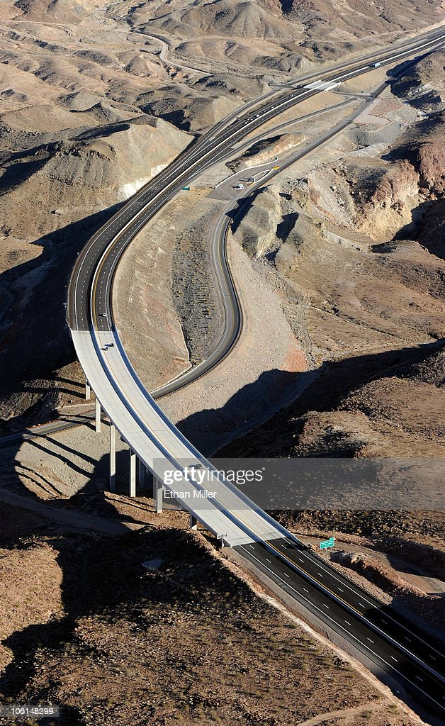 An aerial view of the Arizona approach road to the Mike O'Callaghan-Pat Tillman Memorial Bridge part of the Hoover Dam Bypass Project October 26, 2010 in the Lake Mead National Recreation Area, Arizona. The 1,900-foot-long structure sits 890 feet above the Colorado River, about a quarter of a mile downstream from the Hoover Dam. The USD 240 million four-lane bypass project to relieve vehicle traffic on the Hoover Dam began in 2003, and opened to traffic on October 19.