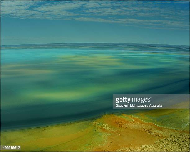 An Aerial view of the Australian outback in flood around Lake Eyre, showing the vibrant colours of the Landscape