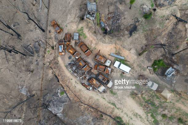 An aerial view of the bare earth blackened bush and cars burnt by fire on January 14 2020 in Wytaliba Australia On the afternoon of November 8...