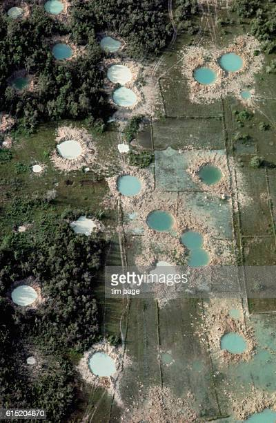 An aerial view of the bomb damage and impact craters left after a US B52 bombing strike north of Dai Teng 1968 | Location north of Dai Teng Vietnam