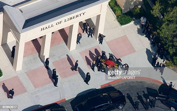 An aerial view of the casket being carried out after a private funeral ceremony for US pop star Michael Jackson at Forest Lawn Cemetery in Los...