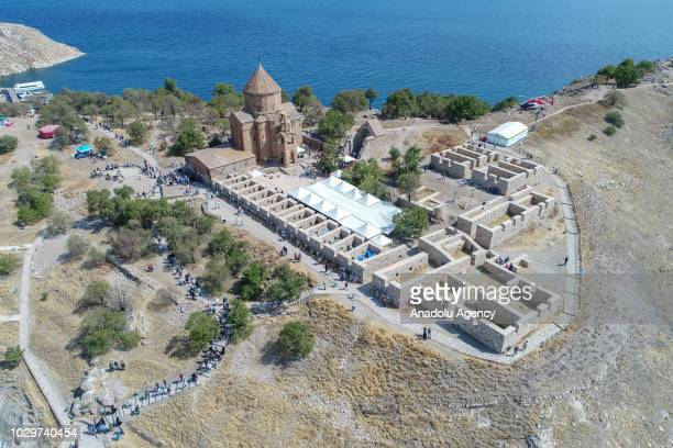 An aerial view of the Cathedral of the Holy Cross on Akdamar Island as people from Turkey and around the world arriving with boats from Akdamar shore...