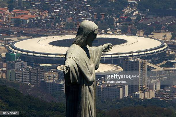 An aerial view of the Christ The Redeemer statue and the Maracana Stadium on November 12, 2013 in Rio de Janeiro, Brazil.