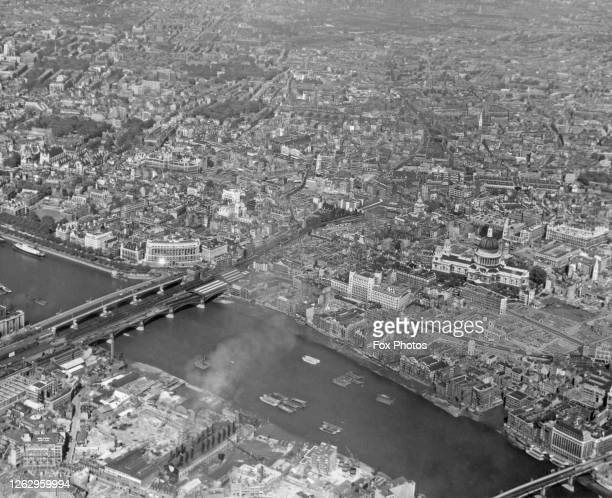 An aerial view of the City of London showing the South Bank of the River Thames in the foreground St Paul's Cathedral in centre right and Blackfriars...