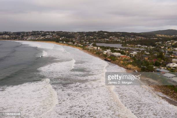 An aerial view of the coastal erosion to local homes in the suburb of Wamberal on July 17, 2020 in Central Coast, Australia. Beachfront homes along...