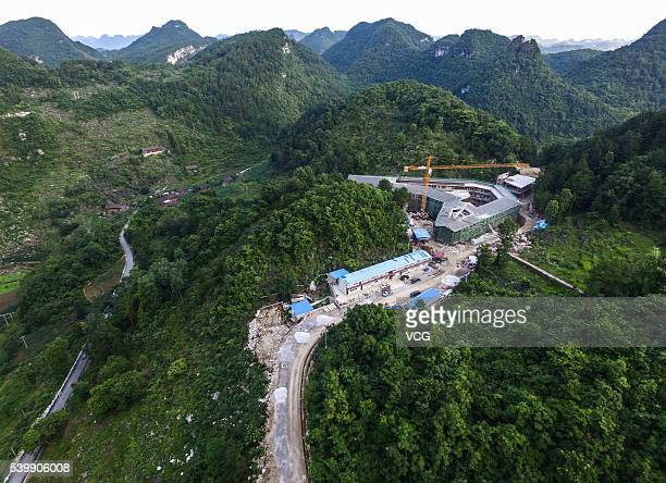 An aerial view of the construction of ancillary facilities around the Five hundred meter Aperture Spherical Telescope on June 10 2016 in Qiannan...