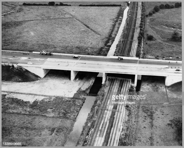An aerial view of the construction of the Birmingham to Preston Motorway , showing the Creswell Viaduct crossing the Stafford-Crewe main railway line...