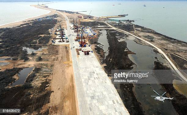 An aerial view of the construction site of a bridge across the Strait of Kerch The Russian government plans to build a bridge linking mainland Russia...