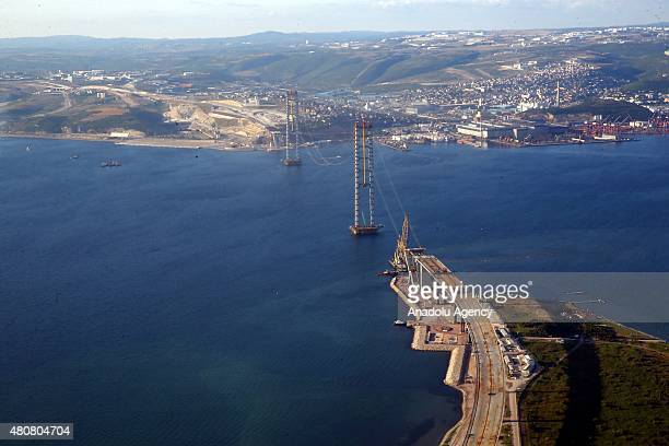 An aerial view of the construction site of the world's largest suspension bridge for the GebzeIzmir Highway during President of Turkey Recep Tayyip...