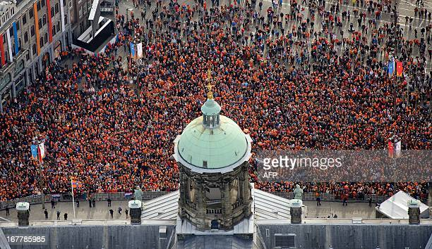 An aerial view of the crowd gathering in front of the Royal Palace on Dam Square in Amsterdam during the official abdication ceremony of Queen...