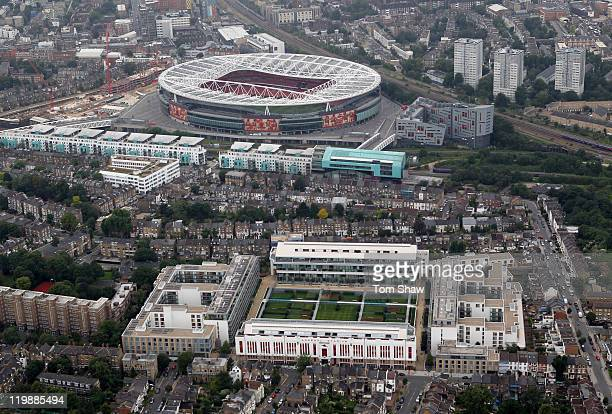 An aerial view of The Emirates Stadium home of Arsenal Football Club with their former home Highbury in the foreground on July 26 2011 in London...