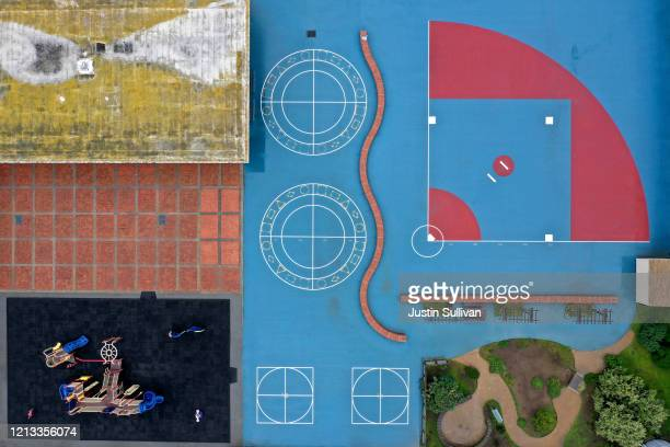 An aerial view of the empty schoolyard at Ulloa Elementary School on March 18 2020 in San Francisco California As millions of Americans shelter in...