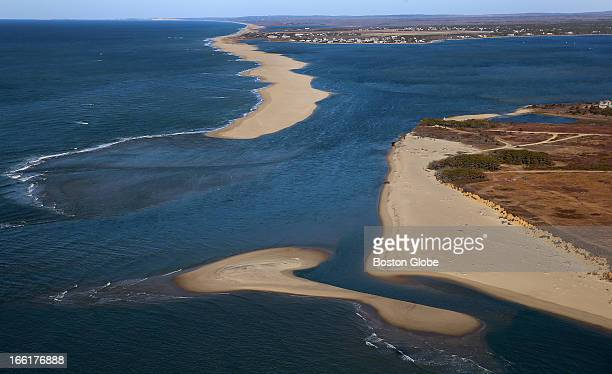 An aerial view of the eroding shoreline at Chappaquiddick Island near Wasque Point A view of the Norton Beach break a big hole punched through the...