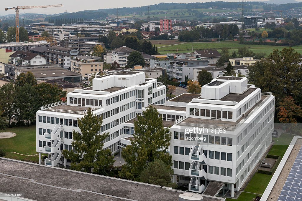 An aerial view of the exterior of the Glencore Plc headquarters is seen in the foreground in Baar, Switzerland, on Wednesday, Sept. 30, 2015. Glencore Plc wiped out Monday's record slump as the shares rose for a third day alongside higher metals prices. Photographer: Alessandro Della Bella/Bloomberg via Getty Images