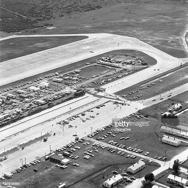 An aerial view of the final turn leading onto the front straight and pit road of Sebring International Raceway. Pedestrian access to the pit area...