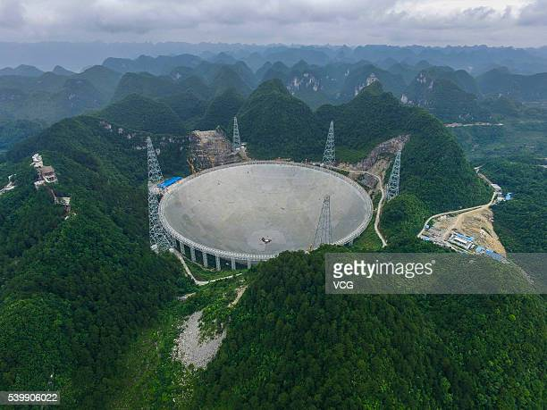 An aerial view of the Five hundred meter Aperture Spherical Telescope on June 10 2016 in Qiannan Buyei and Miao Autonomous Prefecture China After...