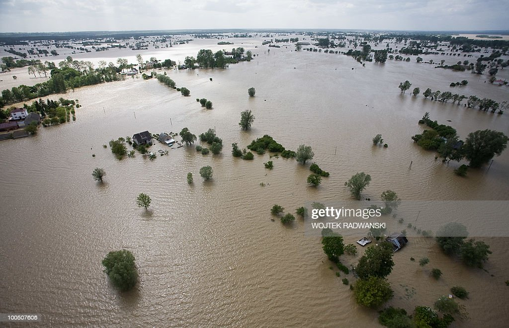 An aerial view of the flooded area of Swiniary village in central Poland at Wisla river is seen on May 25, 2010. Floods caused by torrential rains last week have swollen major Polish rivers to their highest levels in more than a century and have claimed 15 lives.