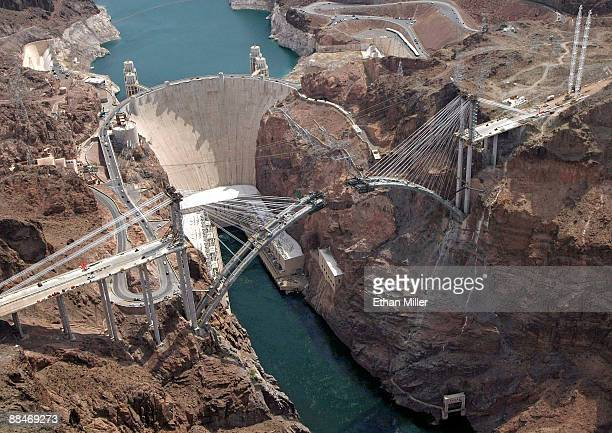 An aerial view of the Hoover Dam and the Hoover Dam bypass under construction June 12 2009 in the Lake Mead National Recreation Area Nevada
