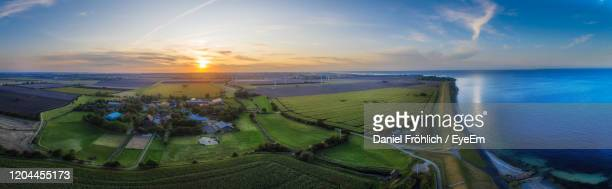 an aerial view of the island fehmarn with sunset - fehmarn stock-fotos und bilder