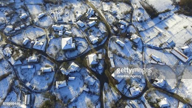 An aerial view of the Istrancalar is seen after season's first snowfall in Kirklareli Turkey on November 21 2017 People decorate their deceased...