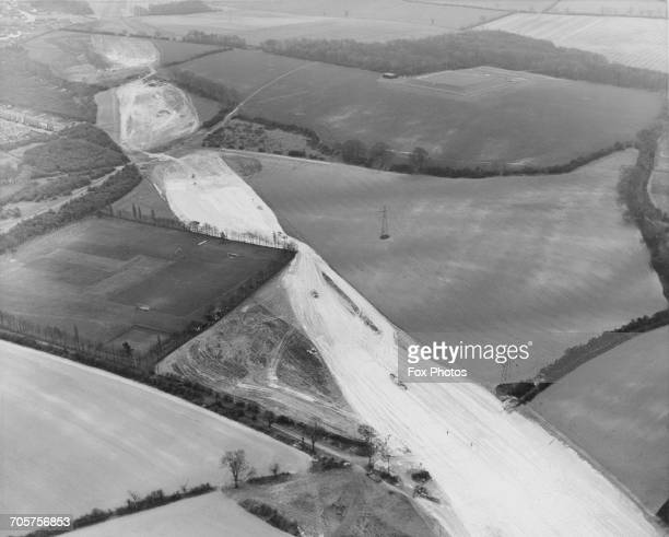 An aerial view of the Jackson Industries Ltd football teams pitch which has been temporarily bypassed by the new construction of the M1 Motorway...