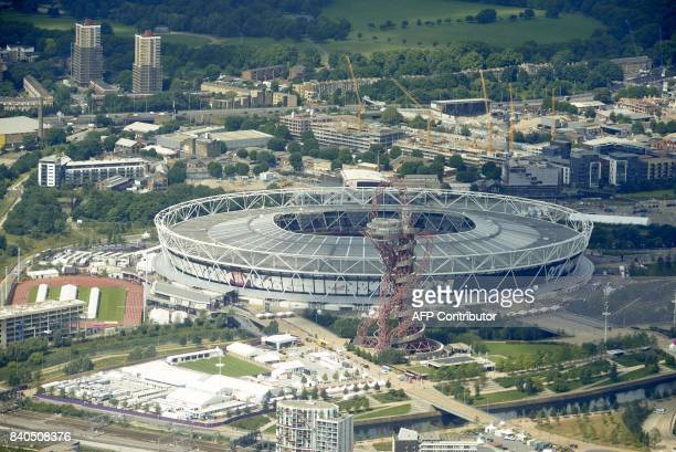 An aerial view of the London Stadium and ArcelorMittal Orbit is pictured during a flight over the capital London in a Cessna 172 plane on August 1...