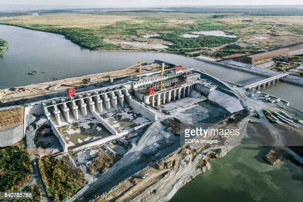An aerial view of the Lower Sesan II Dam under construction Local communities refuse to be removed Once the dam is in operation the waters will raise...