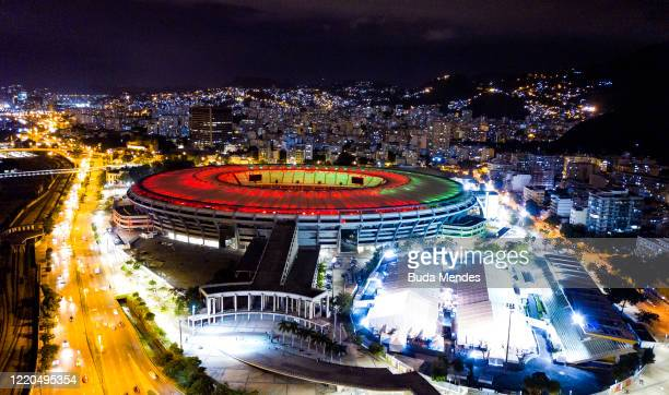 An aerial view of the Maracana stadium illuminated in black and red and green, white and garnet amidst the coronavirus pandemic on June 16, 2020 in...