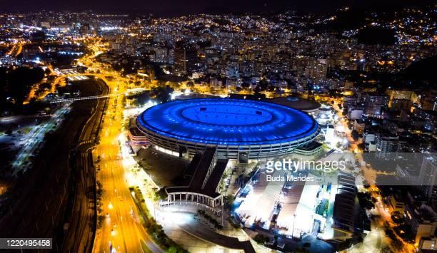 An aerial view of the Maracana stadium illuminated in blue amidst the coronavirus pandemic on June 16, 2020 in Rio de Janeiro, Brazil. The Maracana...