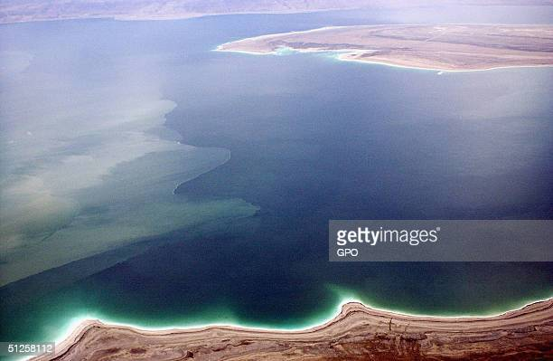 An aerial view of the mineral-rich Dead Sea March 26, 2003 in southern Israel. The inland sea which separates Israel and Jordan is retreating by...