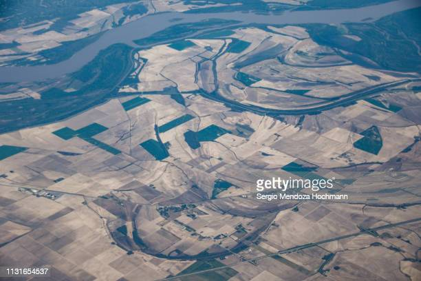 an aerial view of the mississippi river near memphis, tennessee, united states - river mississippi stock photos and pictures