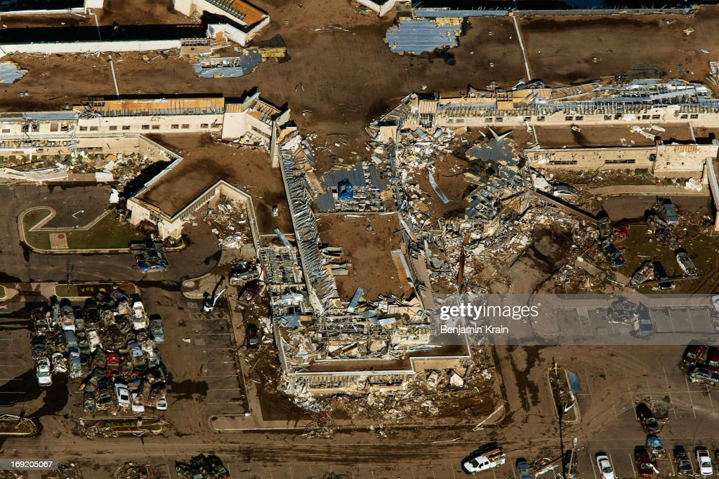 An aerial view of the Moore Medical Center destroyed after a powerful tornado ripped through the area on May 21, 2013 in Moore, Oklahoma. The town reported a tornado of at least EF4 strength and two miles wide that touched down yesterday killing at least 24 people and leveling everything in its path. U.S. President Barack Obama promised federal aid to supplement state and local recovery efforts.