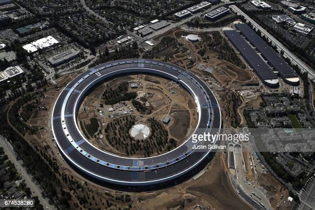 An aerial view of the new Apple headquarters on April 28 2017 in Cupertino California Apple's new 'spaceship' 175acre campus dubbed Apple Park is...