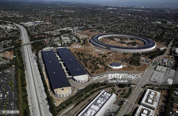 An aerial view of the new Apple headquarters on April 28 2017 in Cupertino California Apple's new 175acre 'spaceship' campus dubbed Apple Park is...