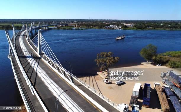 An aerial view of the newly built Kazungula bridge over the Zambezi river in Kazungula, Botswana, on May 10, 2021. - A new road and rail bridge...