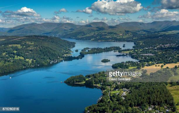 An aerial view of the northern end of Lake Windermere, Bowness-on-Windermere and the lake District mountains in the background on July 12, 2017 in...