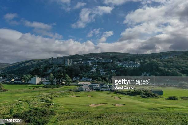 An aerial view of the par 3, 18th hole and clubhouse with Harlech Castle on the hill behind at Royal St Davids Golf Club on October 07, 2020 in...