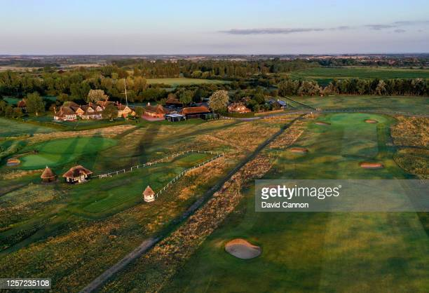 An aerial view of the par 4, 18th hole with the first tee and clubhouse area at the host venue for the 2021 Open Championship at The Royal St....